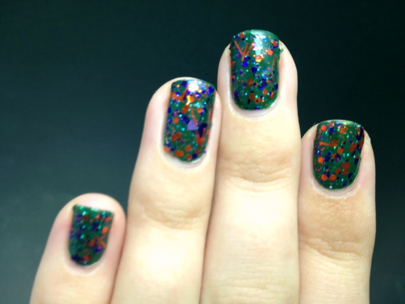 Left hand. It was so hard to get a good photo, but in real life the glitter stood out much more against the dark green.