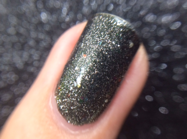 See how the colored pieces are barely visible under the gray base and gunmetal micro glitter?
